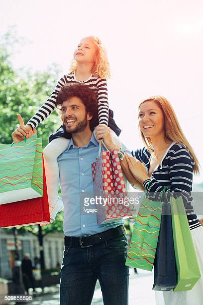 Family with One Child Enjoy Shopping Together