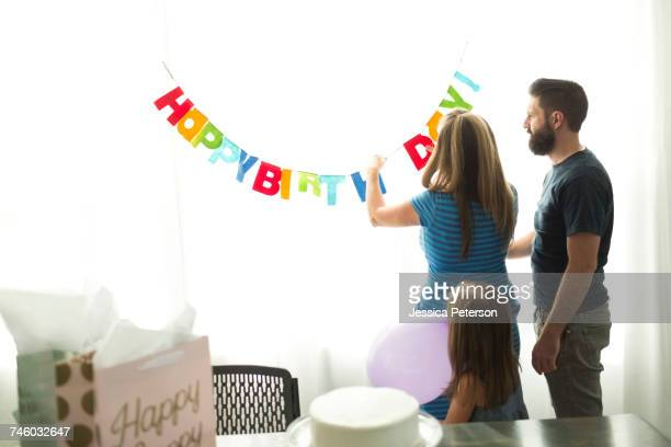 Family with one child (6-7) preparing birthday party
