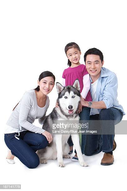 Family with pet husky