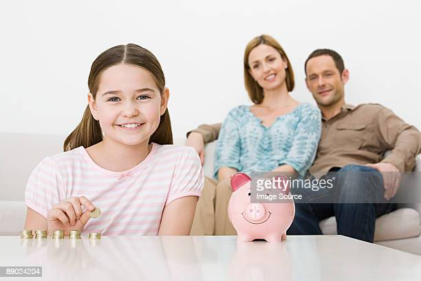 Family with piggy bank