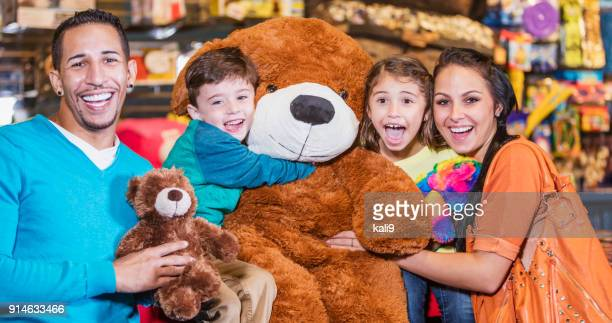 Family with prizes in amusement arcade