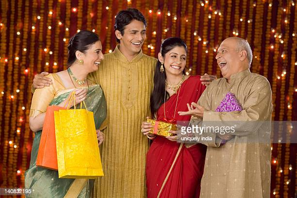 family with shopping bags and diwali gift - kurta stock pictures, royalty-free photos & images