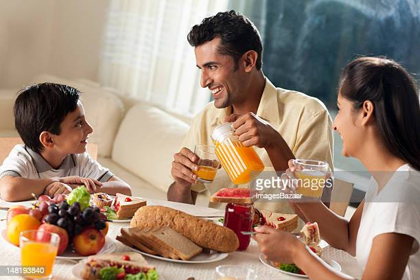 Family with son (6-7) having breakfast