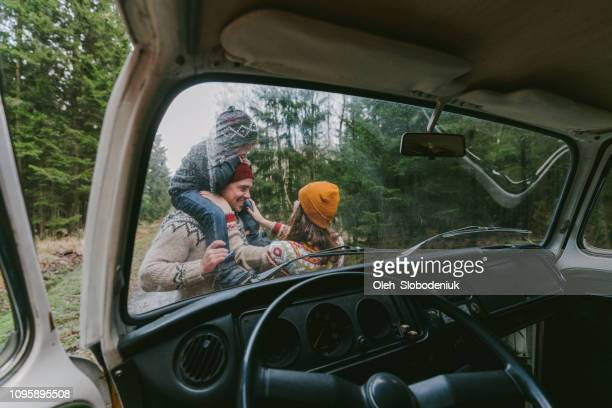 family with son  near the van in forest - country christmas stock pictures, royalty-free photos & images