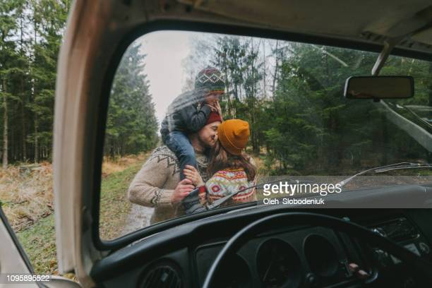 Family with son  near the van in forest