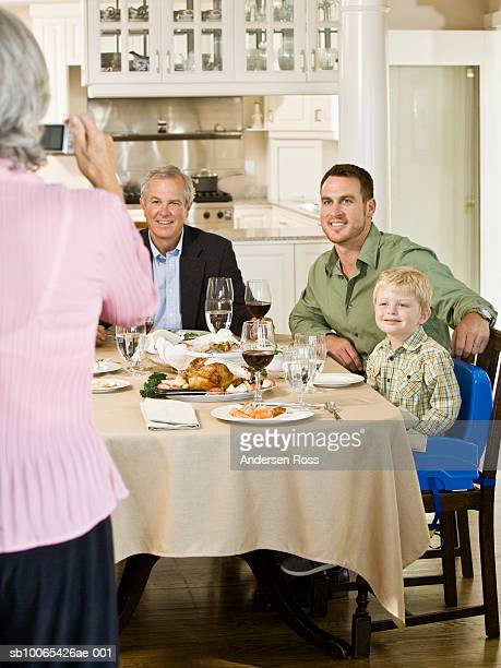 family with son (2-3 years) posing for photograph - 55 59 years stock pictures, royalty-free photos & images
