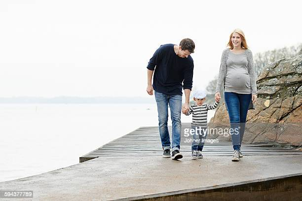 Family with son walking on jetty