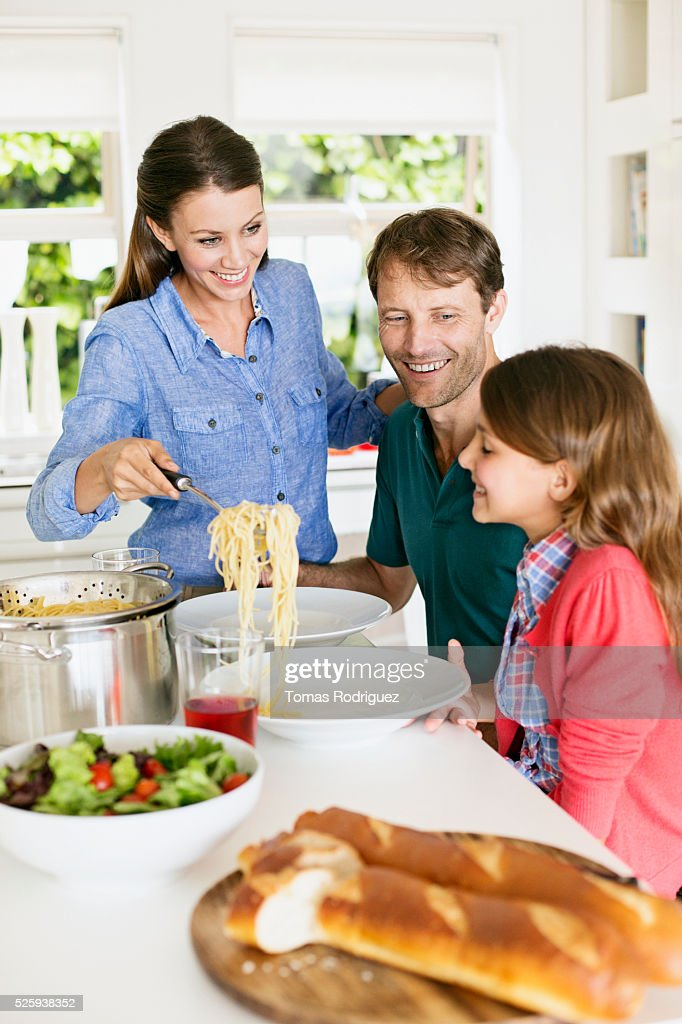 Family with teenage girl (13-15) eating spaghetti : Bildbanksbilder