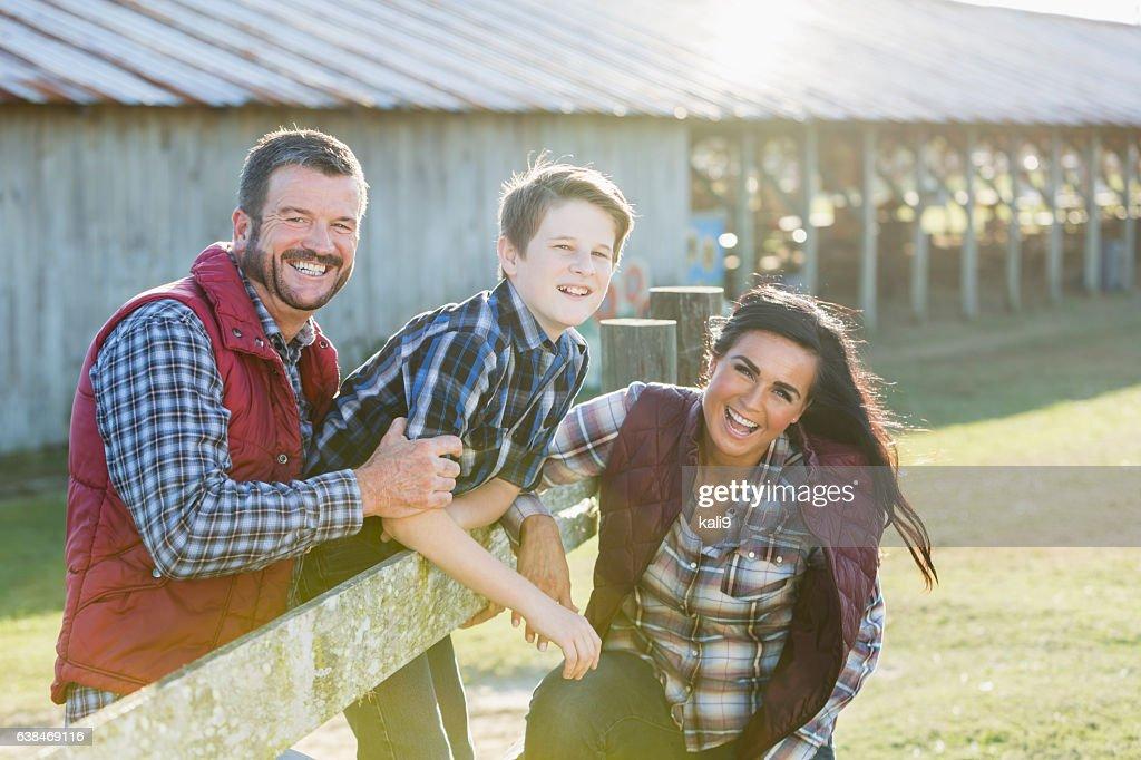 Family with teenage son on a farm : Stock Photo