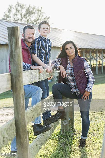 Family with teenage son on a farm