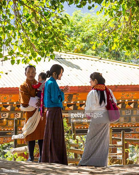 A family with their baby in the monastery in the village Chimi Lhakhang in the Punakha Valley with its temple monastery is renowned for its fertility...
