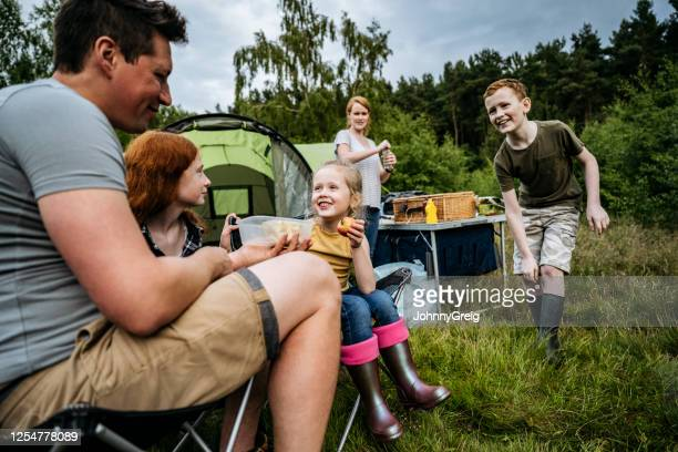 family with three children enjoying picnic at campsite - two parents stock pictures, royalty-free photos & images