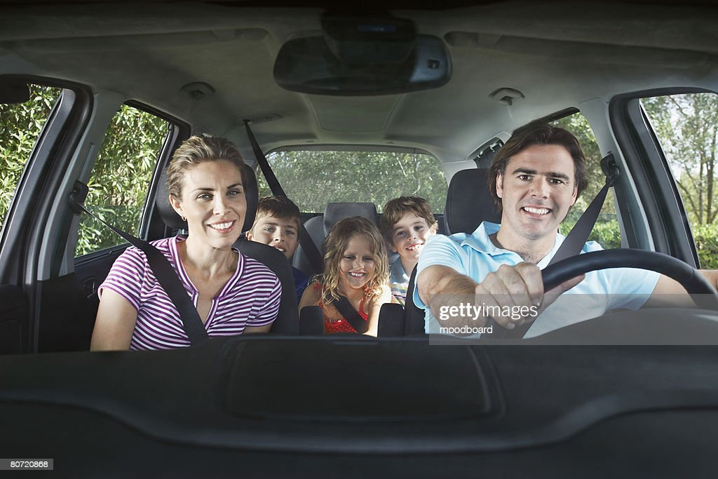 Family with three children (5-11) in car interior portrait : Stock Photo