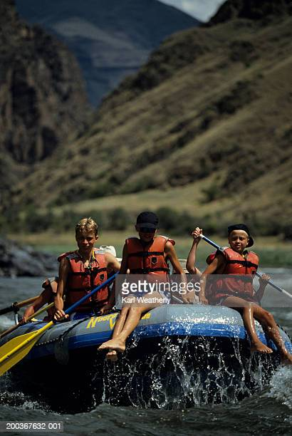 Family with three children (12-13), (14-15) rafting, Lower Salmon River, Idaho, USA
