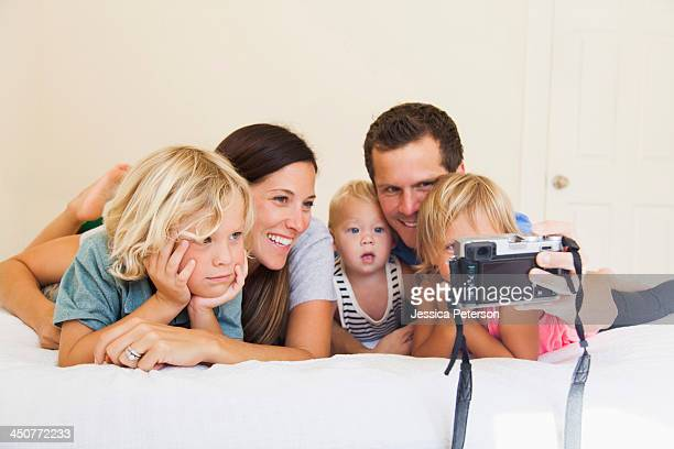 Family with three kids (6-7, 2-3, 6-11 months) photographing themselves
