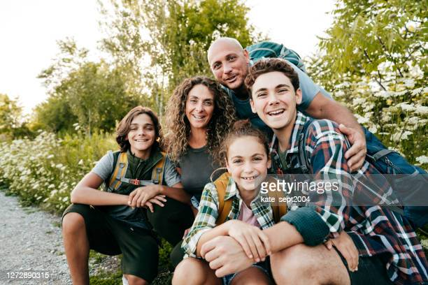 family with three kids smiling at camera, and posing at the park in ontario. - five people stock pictures, royalty-free photos & images