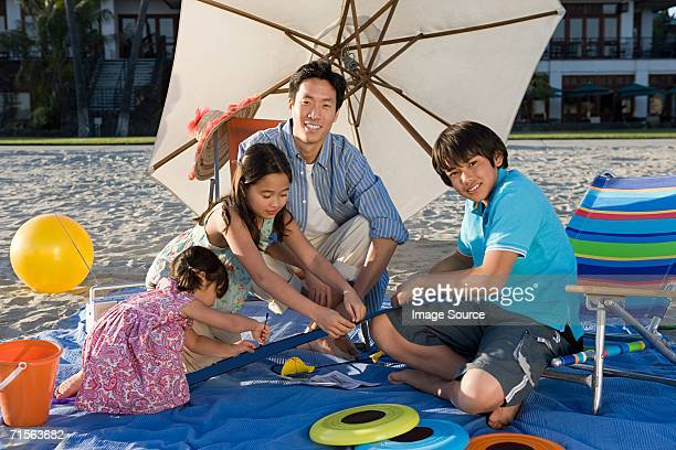 Family with toy aeroplane