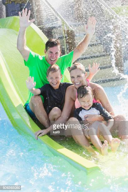 Family with two boys on waterslide at a water park