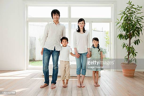 Family with two children at home, portrait
