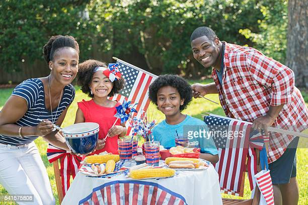 family with two children celebrating 4th of july - independence day holiday stock photos and pictures