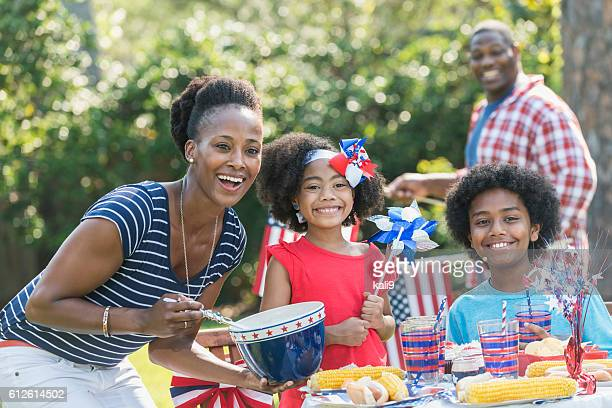Family with two children celebrating 4th of July