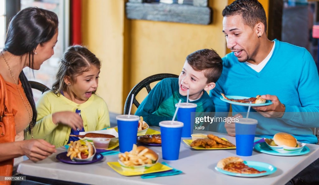 Family with two children eating fast food : Stock Photo