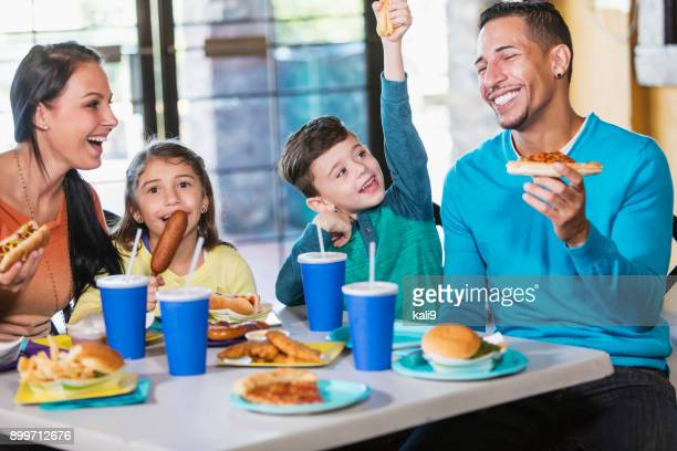 Family with two children eating fast food