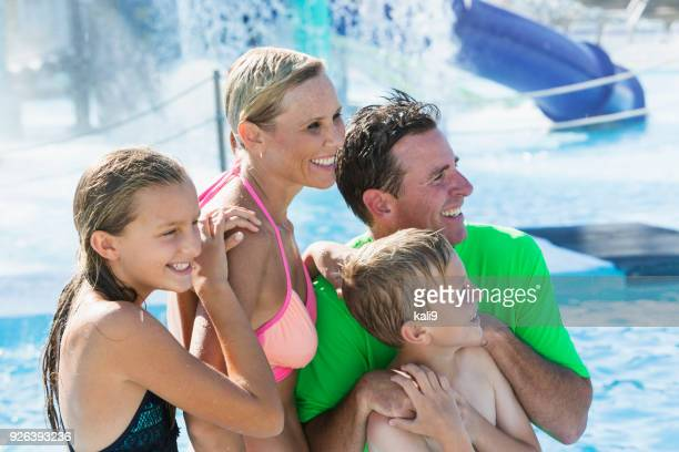 Family with two children enjoying water park