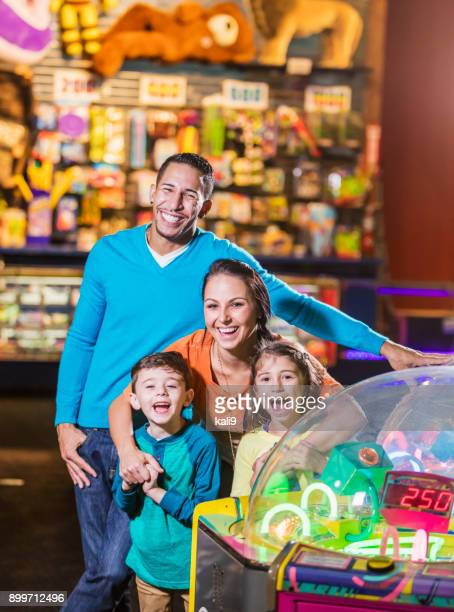 Family with two children in amusement arcade