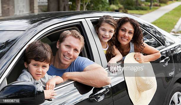Family with two children in car