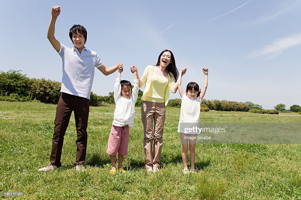 Family with two children in field : Stock Photo