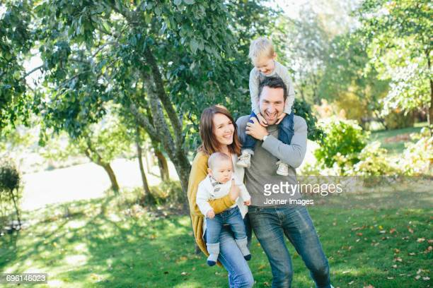 Family with two children in park