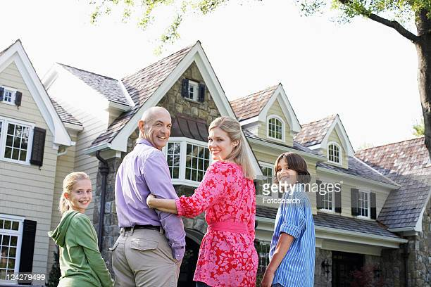 family with two children near house, chatham, new jersey, usa - three quarter length stock-fotos und bilder