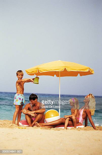 Family with two children (6-9) on beach