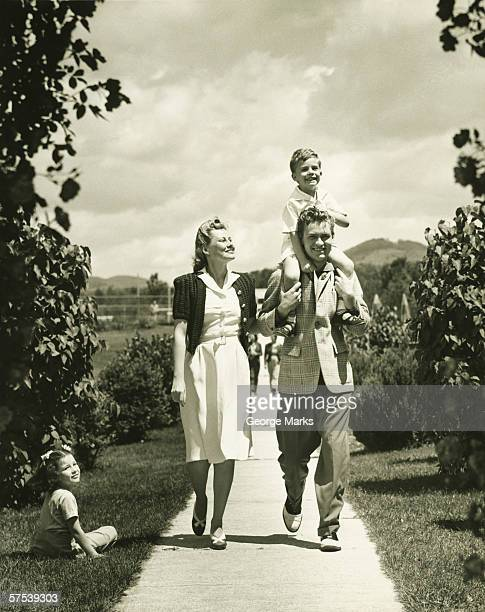family with two children (4-5) on walk, (b&w) - 20th century stock photos and pictures