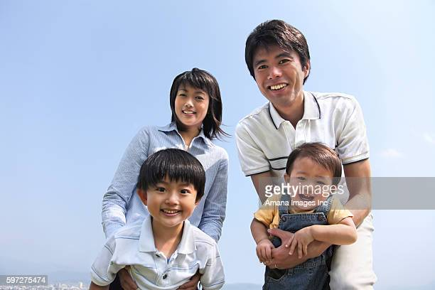 Family with Two Children Smiling at Camera