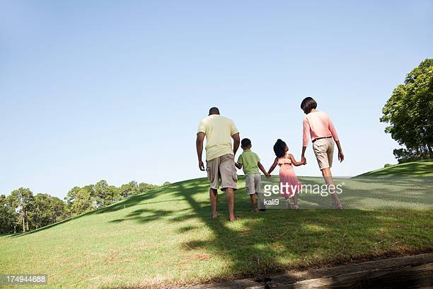 Family with two children walking up a hill