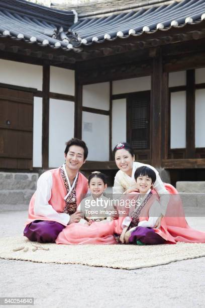 Family with two children wearing Korean traditional costumes, Korean