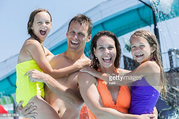 Family with two girls having fun at water park
