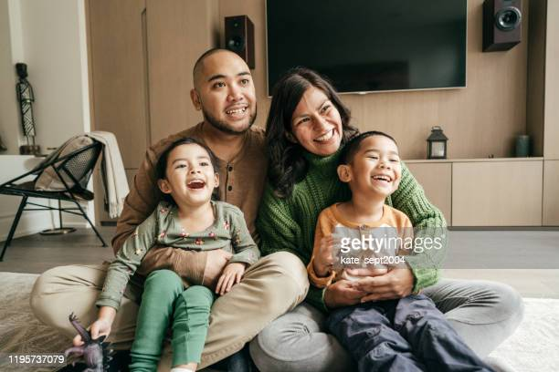 family with two kids - immigrant stock pictures, royalty-free photos & images