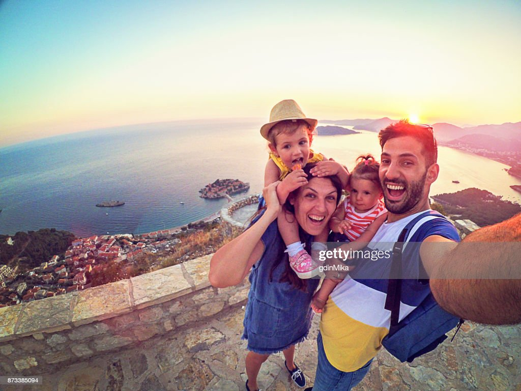 Family with two little daughters travel in nature, making selfie, smiling : Stock Photo