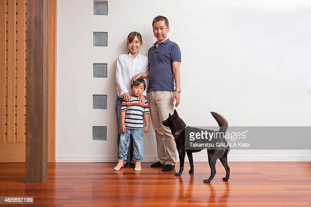 family with young son and pet dog - japanese spitz stock pictures, royalty-free photos & images