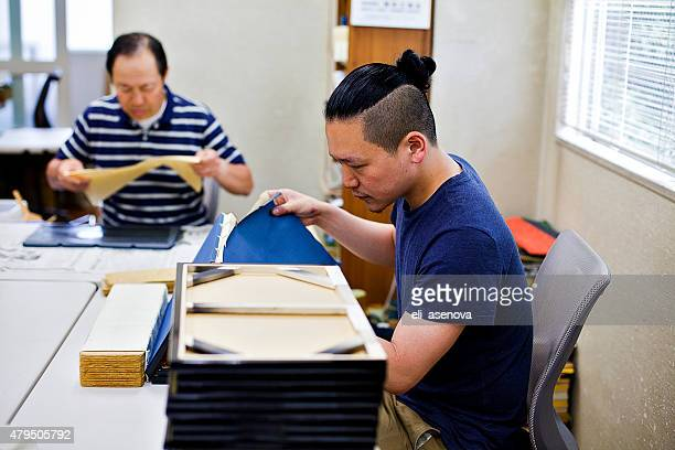Family work on the wooden craft boxes, Tokyo.