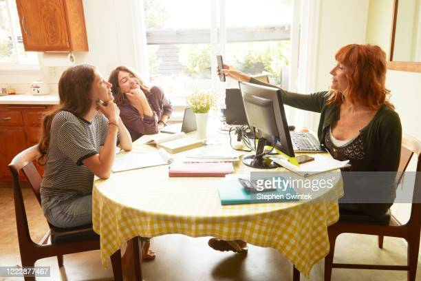 family working and studying at home - homeschool stock pictures, royalty-free photos & images