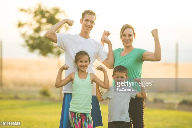 family working out together - flexing muscles stock pictures, royalty-free photos & images