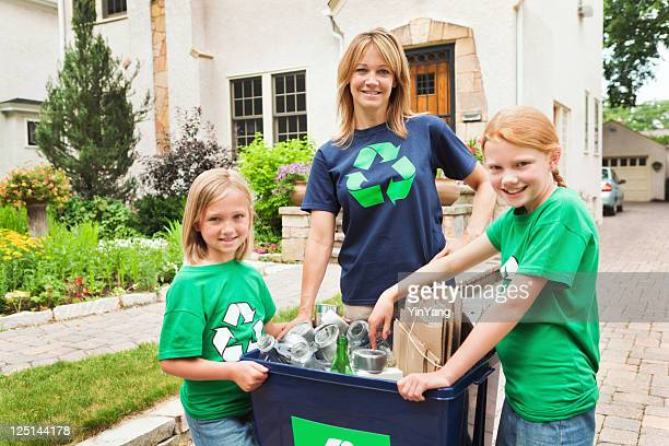 Family Working Together in Community Recycling Effort Hz