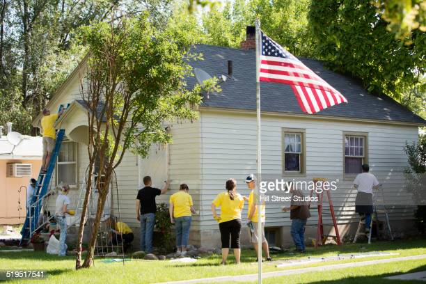 family working together on house - flagpole stock pictures, royalty-free photos & images