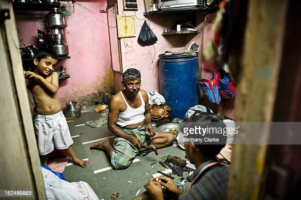 A family works in their home in Dharavi November 4 2011 in Mumbai India Dharavi Asia's largest slum situated in the centre of Mumbai One million...