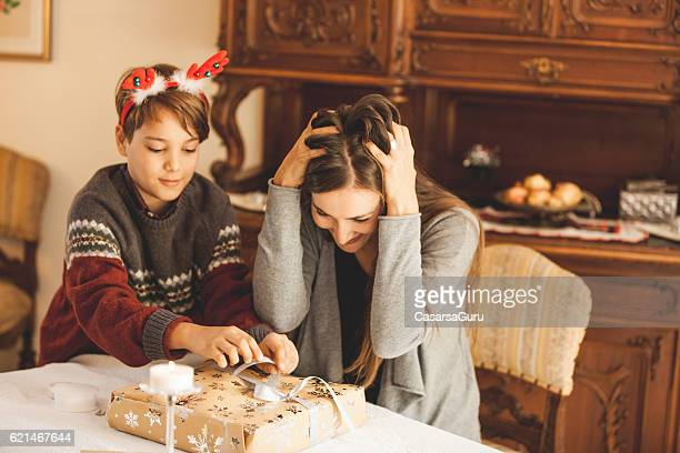 Family Wrapping Christmas Gifts at Home