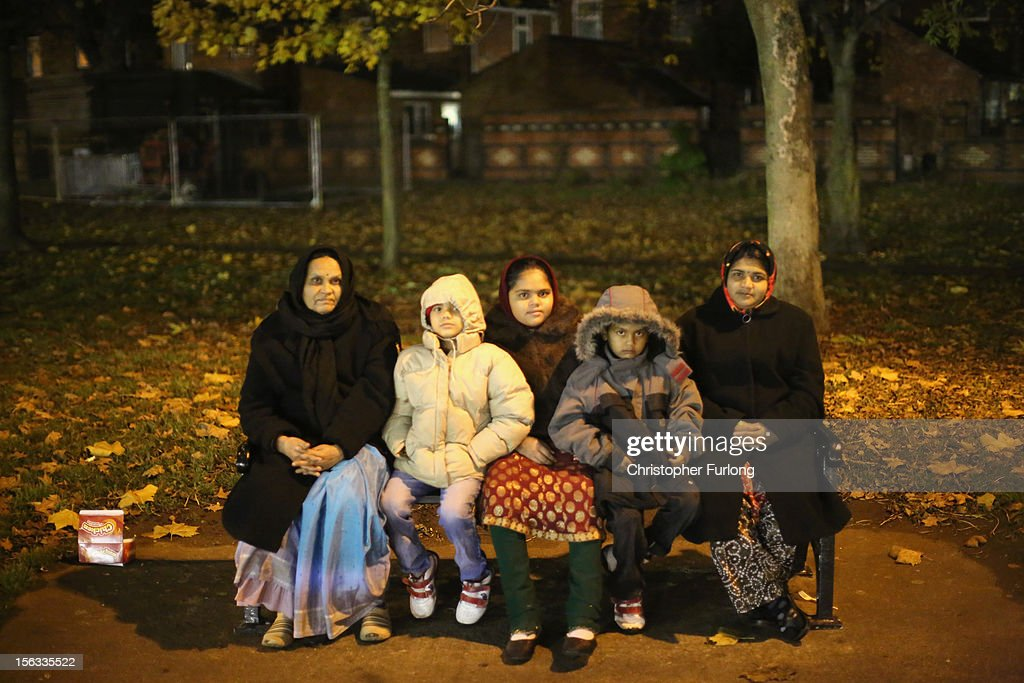A family wraps up against the cold to watch fireworks during the Hindu festival of Diwali on November 13, 2012 in Leicester, United Kingdom. Up to 35,000 people attended the Diwali festival of light in Leicester's Golden Mile in the heart of the city's asian community. The festival is an opportunity for Hindus to honour Lakshmi, the goddess of wealth and other gods. Leicester's celebrations are one of the biggest in the world outside India. Sikhs and Jains also celebrate Diwali.